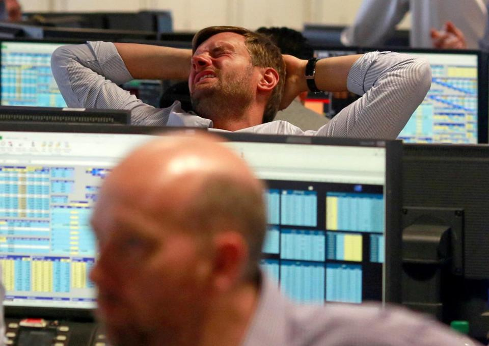 A trader from BGC, a global brokerage company in London's Canary Wharf financial centre reacts during trading June 24, 2016 after Britain voted to leave the European Union in the EU BREXIT referendum. REUTERS/Russell Boyce