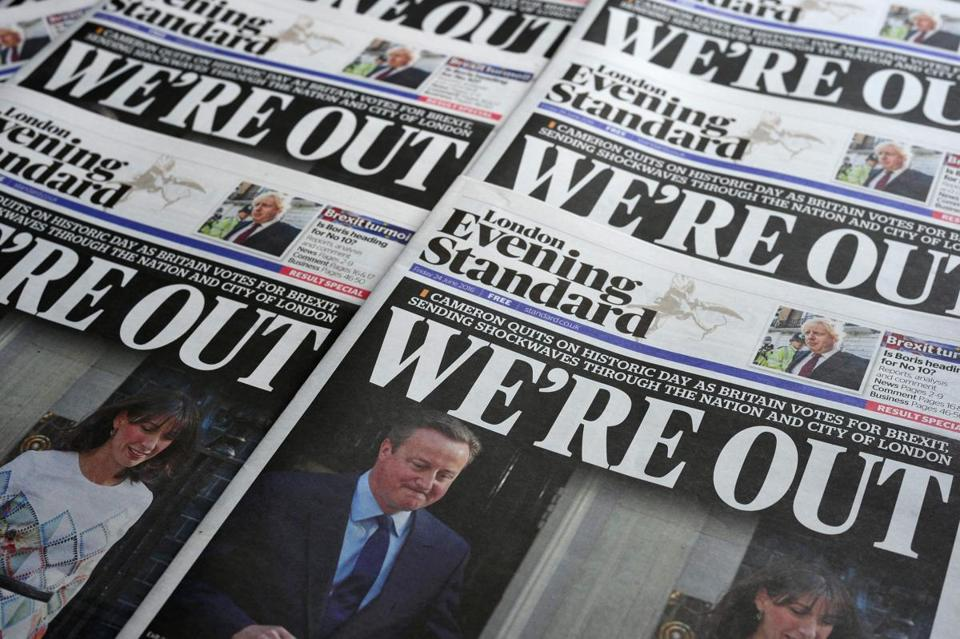 An arrangement of newspapers pictured in London on June 24, 2016, as an illustration, shows the front page of the London Evening Standard newpaper reporting the resignation of British Prime Minister David Cameron following the result of the UK's vote to leave the EU in the June 23 referendum. Cameron is pictured holding hands with his wife Samantha as they come out from 10 Downing Street. Britain voted to break away from the European Union on June 24, toppling Prime Minister David Cameron and dealing a thunderous blow to the 60-year-old bloc that sent world markets plunging. / AFP PHOTO / Daniel SORABJIDANIEL SORABJI/AFP/Getty Images