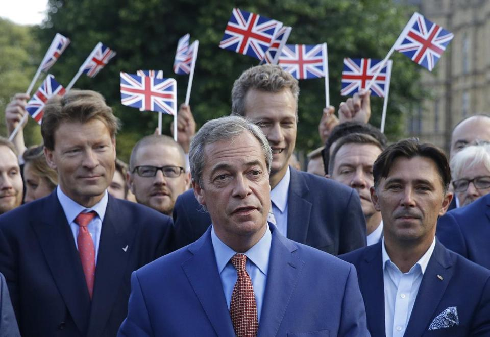 FILE - In this Friday, June 24, 2016 file photo, Nigel Farage, the leader of the UK Independence Party speaks to the media on College Green in London, Friday, June 24, 2016. (AP Photo/Matt Dunham, File)