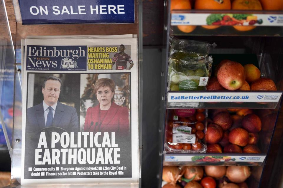 Newspapers reporting on the pro-Brexit result of the UK's EU referendum vote and with an image of British Prime Minister David Cameron and Scotland's First Minister and Leader of the Scottish National Party (SNP), Nicola Sturgeon, are pictured in a store in Edinburgh, Scotland on June 25, 2016. The result of Britain's June 23 referendum vote to leave the European Union (EU) has pitted parents against children, cities against rural areas, north against south and university graduates against those with fewer qualifications. London, Scotland and Northern Ireland voted to remain in the EU but Wales and large swathes of England, particularly former industrial hubs in the north with many disaffected workers, backed a Brexit. / AFP PHOTO / OLI SCARFFOLI SCARFF/AFP/Getty Images