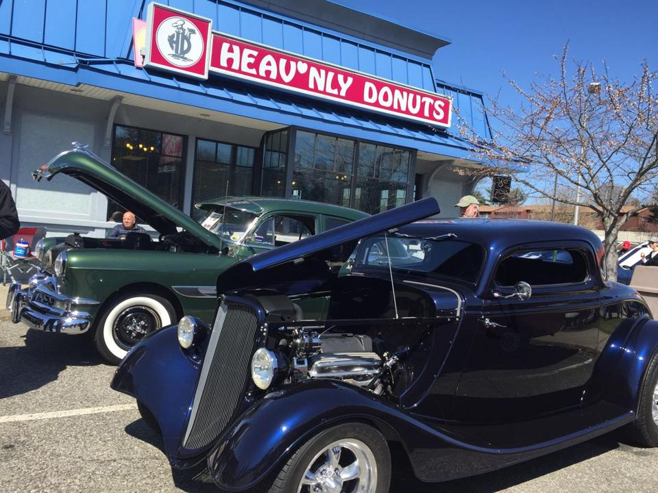Classic cars fill the parking lot on Sundays at Heav'nly Donuts in Derby, Conn.