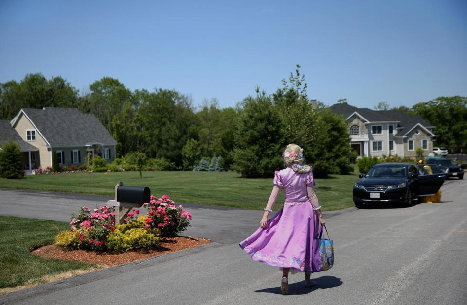 ANDOVER, MA - 6/25/2016: Catherine Busby, of Sterling, Massachusetts, walks in her Rapunzel costume to meet fellow princess Katherine Copeland before a birthday party for Emma Genest in Andover, Massachusetts, on Saturday, June 25, 2016. The princess-themed party included dancing, games and face painting. (Timothy Tai for The Boston Globe)