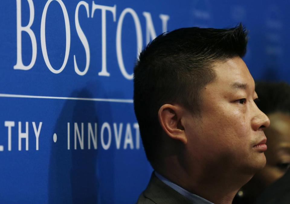 Boston, MA - 6/28/2016 - Boston Public Schools Superintendent Tommy Chang listens to Mayor Walsh speak after announcing Michael Contompasis as the Boston Latin School interim Head Master in Boston, MA June 28, 2016. Jessica Rinaldi/Globe Staff Topic: 29blspic Reporter: