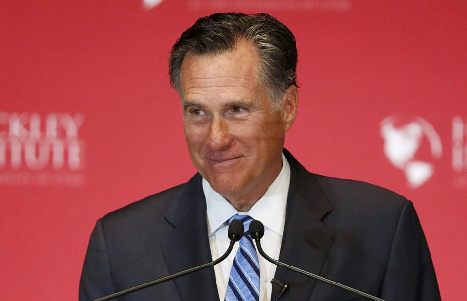 Former Republican U.S. presidential nominee Mitt Romney pauses and smiles as he delivers a speech criticizing current Republican presidential candidate Donald Trump at the Hinckley Institute of Politics at the University of Utah in Salt Lake City, Utah March 3, 2016. REUTERS/Jim Urquhart/File Photo