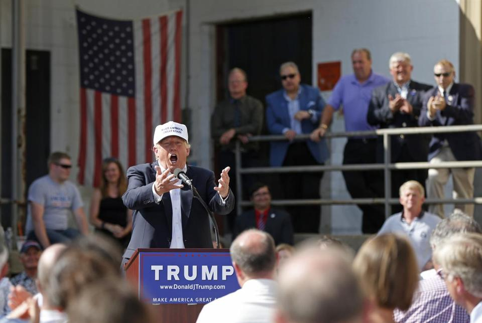 Republican presidential candidate Donald Trump speaks at a town hall-style campaign event at the former Osram Sylvania light bulb factory.
