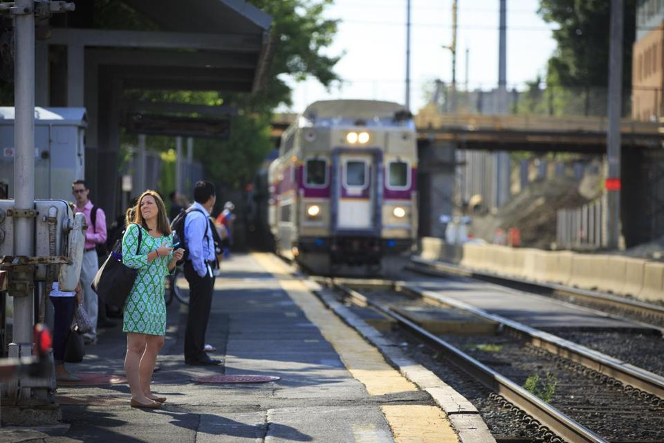 6/20/16 - Chelsea, MA - Commuters boarded an inbound MBTA Commuter Rail train at the Chelsea platform on Monday morning, June 20, 2016. Photo by Dina Rudick/Globe Staff
