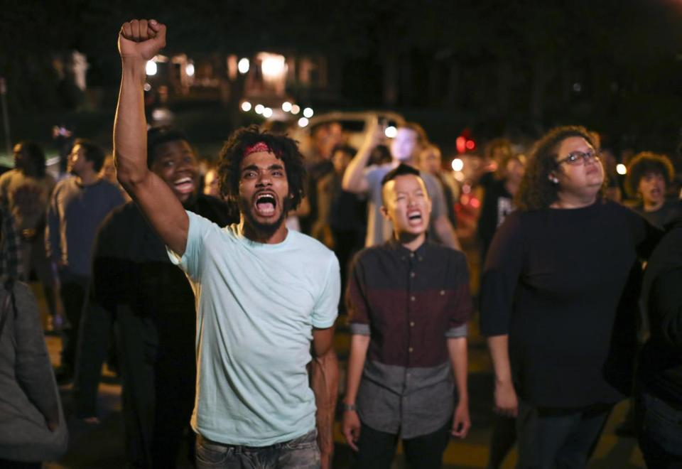 Angry demonstrators chant as they block Summit Ave in front of the Governor's Residence in St. Paul, Minn., early Thursday morning, July 7, 2016. Philando Castile was shot in a car Wednesday night in the largely middle-class St. Paul suburb of Falcon Heights. Police have said the incident began when an officer initiated a traffic stop in suburban Falcon Heights but have not further explained what led to the shooting. (Jeff Wheeler/Star Tribune via AP) -- 10Tycolumn