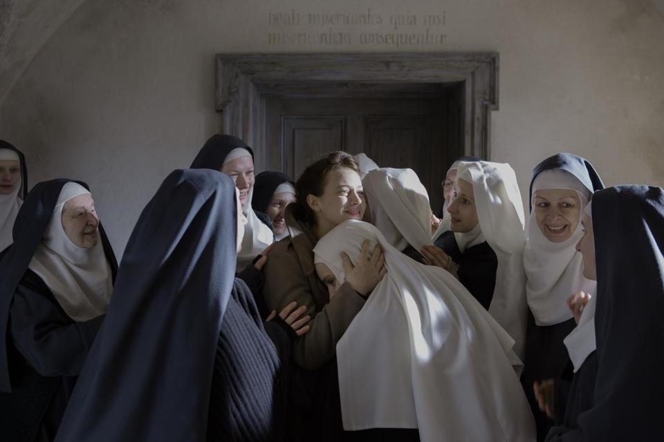 "In ""The Innocents,"" Lou de Laâge (center) stars as a doctor who comes to the aid of nuns in Poland in 1945."