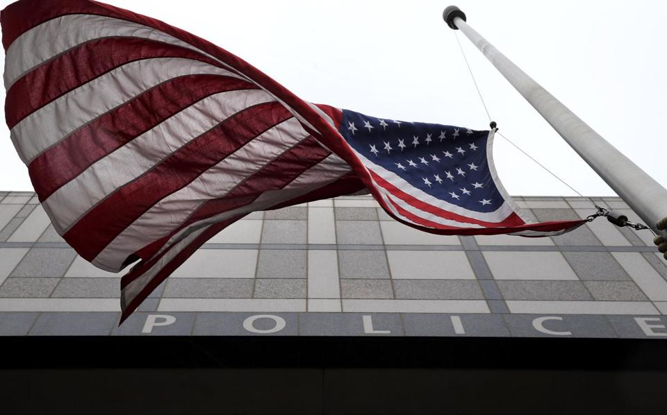 07/08/2016 -Boston, MA - Flags were lowered to half-staff outside Boston Police Department headquarters in Boston, MA on July 08, 2016. (Craig F. Walker/Globe Staff) section: Metro reporter: