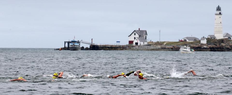 More than 60 swimmers, including Olympians Carlton Bruner, Janel Jorgensen McArdle, Kristy Kowal, and Heather Petri, jumped into Boston Harbor to kick off a 22-mile relay swim around the Boston Harbor Islands in July.