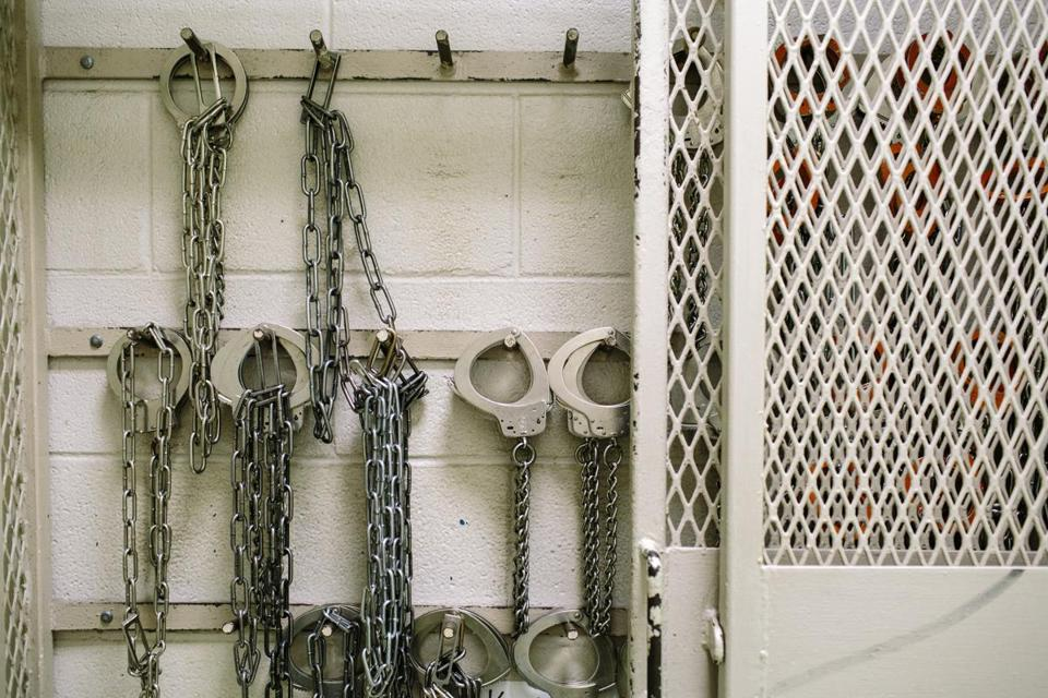 Handcuffs hang on the wall inside Lafayette Parish jail in Lafayette, La., April 19, 2016. Louisiana and some other states with criminal justice systems that treat 17-year-olds as adults appear to be on the verge of raising the cutoff to the more standard age of 18. (William Widmer/The New York Times)