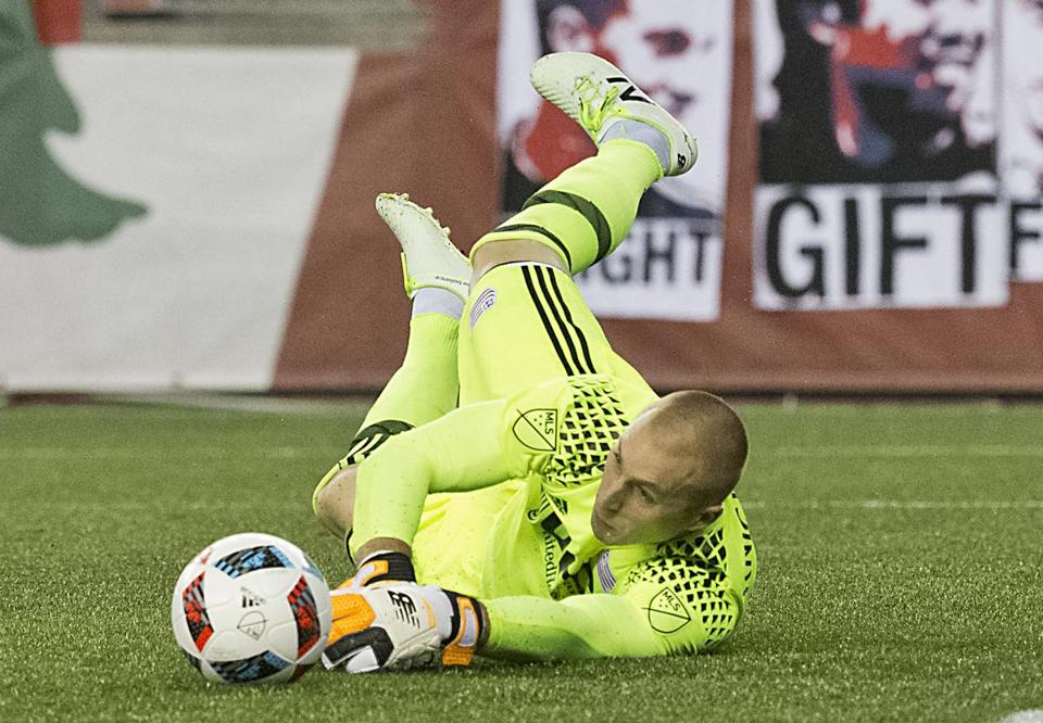 Foxborough MA 7/9/16 New England Revolution goalie Brad Knighton makes a diving save against Columbus Crew SC during first half action at Gillette Stadium on Saturday July 9, 2016. (Photo by Matthew J. Lee/Globe staff) topic: reporter: