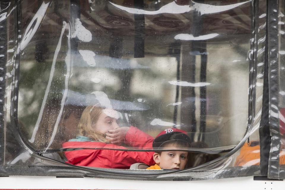 Boston, MA - 07/10/2016 - Passengers look out of the window of a duck boat after it struck a woman in the intersection at Newbury Street and Clarendon Street in Boston, MA, July 10, 2016. (Keith Bedford/Globe Staff)