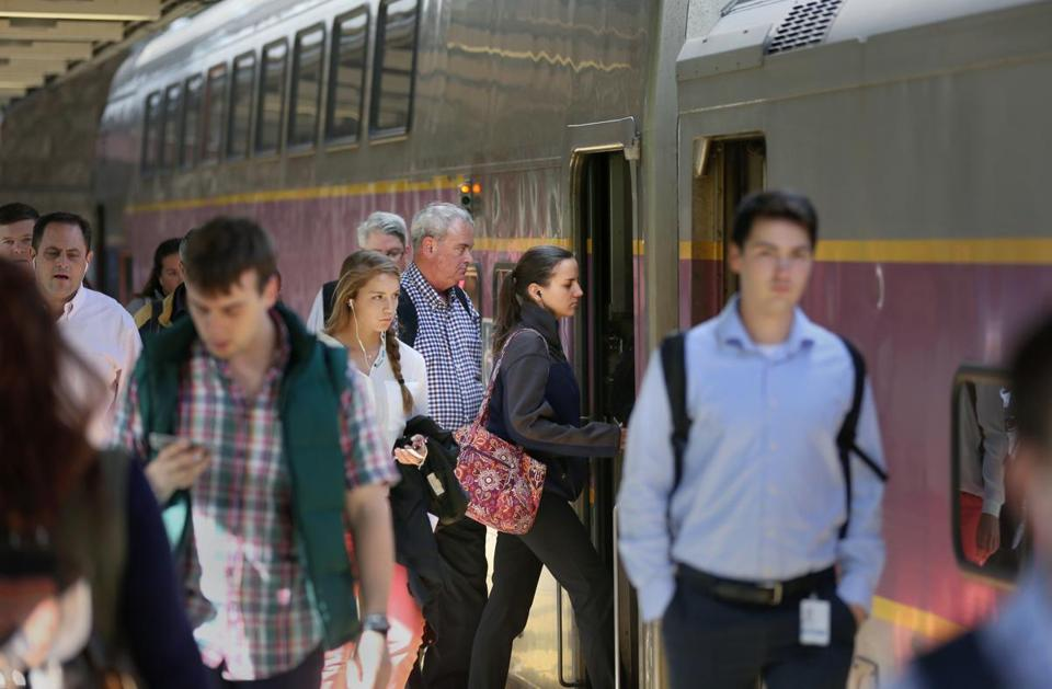 Passengers boarded a Keolis-run MBTA commuter train at South Station last month.