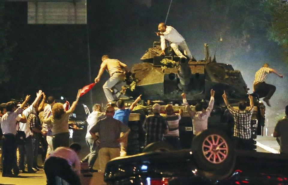 A tank moved into position as Turkish people attempted to stop them, in Ankara, Turkey, early Saturday.