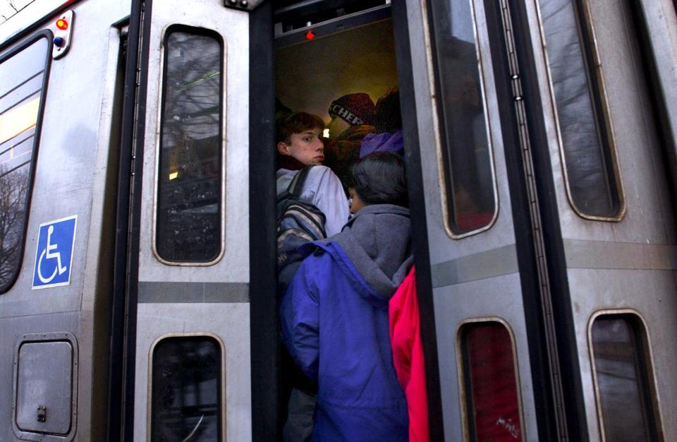 Brookline, MA (Feb 21, 03) - Commuters standing in the stairwell, and the doors have trouble closing, on an overcrowded Riverside train, at the Longwood stop, rush hour. (PHOTO BY SARAH BREZINSKY) Library Tag 02232003 Metro Library Tag 09262004 Ideas