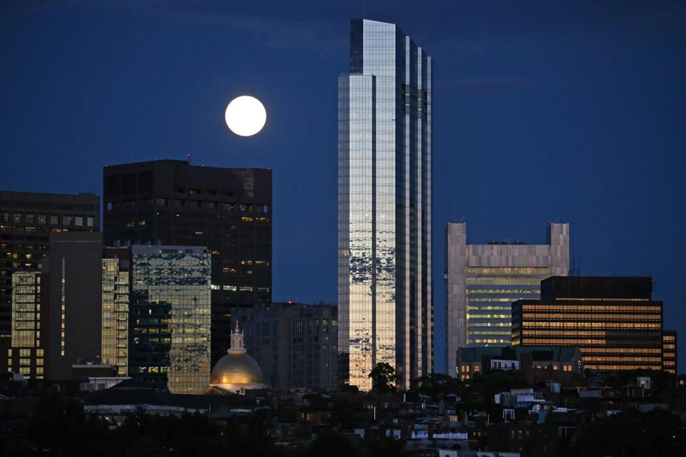 BOSTON, MA - 7/20/2016: A FULL MOON VIEW for the Millennium Tower Boston, downtown crossing at Summer and Washington streets.... Beacon Hill in the foreground an architecture review (David L Ryan/Globe Staff Photo) SECTION: ARTS TOPIC 17Tower
