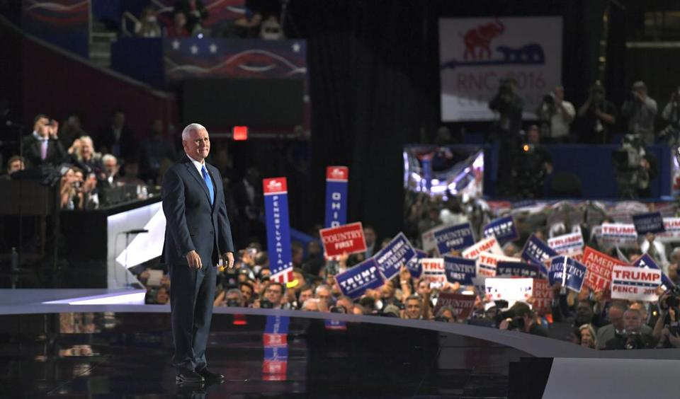 Republican Vice Presidential Nominee Gov. Mike Pence of Indiana stands on the stage following his speech during the third day of the Republican National Convention in Cleveland, Wednesday, July 20, 2016. (AP Photo/Mark J. Terrill)