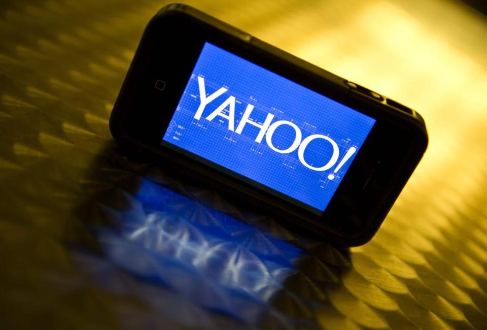 "(FILES) This file photo taken on September 12, 2013 shows the newly designed Yahoo logo seen on a smartphone. Yahoo has agreed to sell its core business to telecom giant Verizon for $4.8 billion, ending a 20-year run by the internet pioneer as an independent company, the firms announced July 25, 2016. Verizon chief executive Lowell McAdam said Yahoo would be integrated into its recently acquired AOL unit to create ""a top global mobile media company, and help accelerate our revenue stream in digital advertising."" / AFP PHOTO / KAREN BLEIERKAREN BLEIER/AFP/Getty Images"