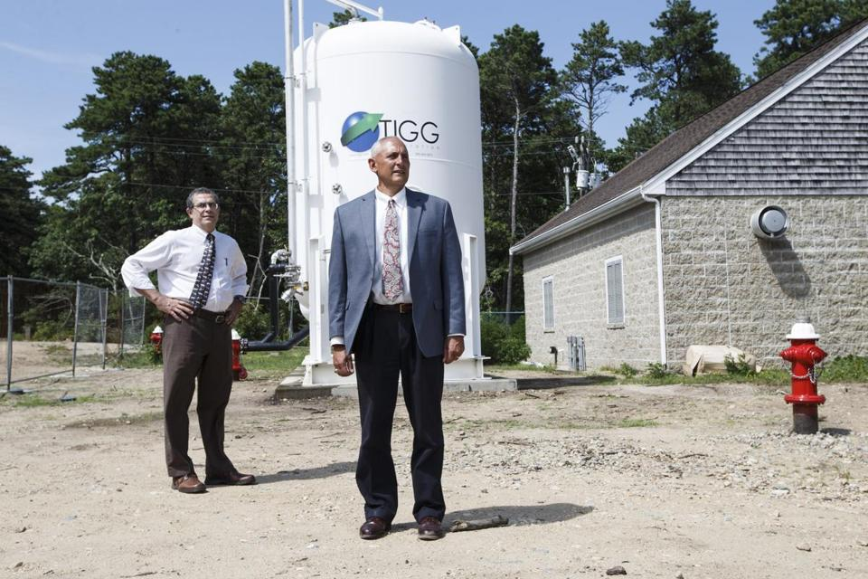 Barnstable, MA - 7/25/2016 - Barnstable Town Manager Mark Ells(R) and Barnstable's Director of Public Works Daniel Santos stand at the water treatment facility in Barnstable, MA, July 25, 2016. (Keith Bedford/Globe Staff)