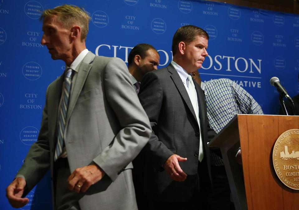 Boston Police Commissioner William Evans and Mayor Marty Walsh at a press conference last week.