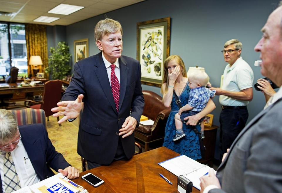 Former Ku Klux Klan leader David Duke, left, registered to run for the US Senate in Baton Rouge, La., on July 22. Accompanying him are his daughter, Erika, center right, and grandson.