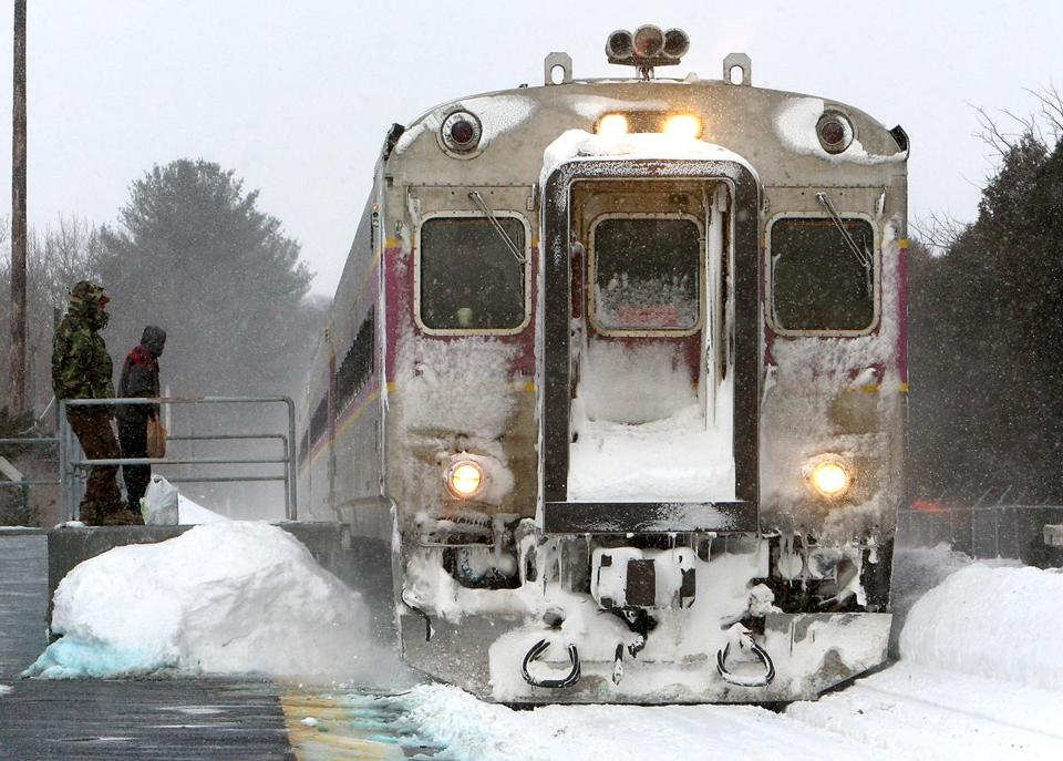 Passengers waited as an MBTA commuter rail train pulled into the North Beverly station on Feb. 17, 2015.