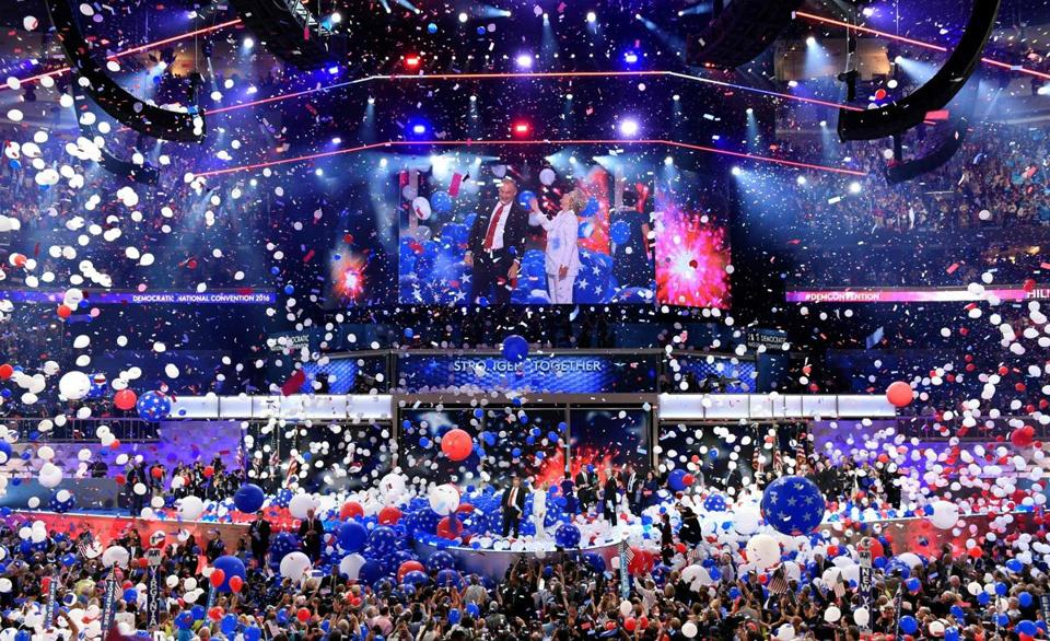Balloons come down on Democratic presidential nominee Hillary Clinton and running mate Tim Kaine at the end of the fourth and final night of the Democratic National Convention at Wells Fargo Center on July 28, 2016 in Philadelphia, Pennsylvania. / AFP PHOTO / SAUL LOEBSAUL LOEB/AFP/Getty Images