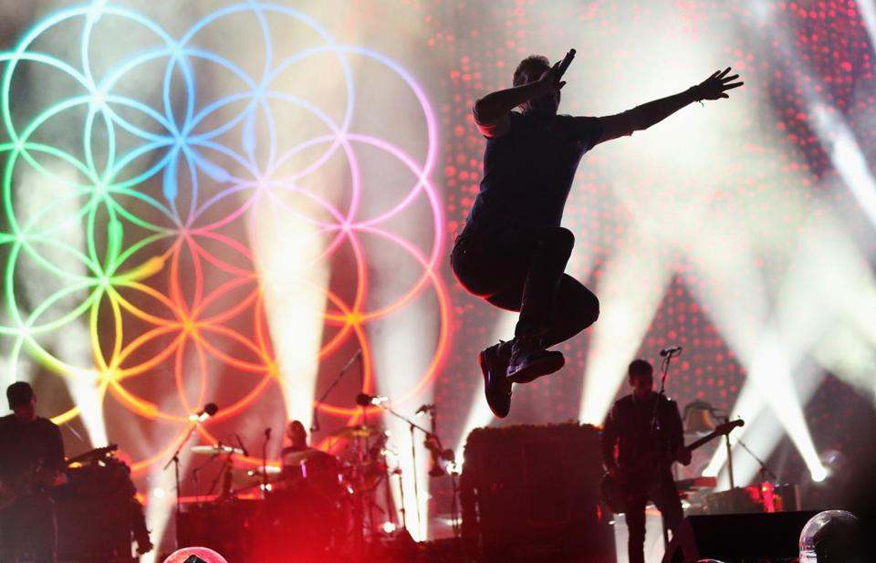 Coldplay performing for a sold-out audience at Gillette Stadium in Foxborough on Saturday night.