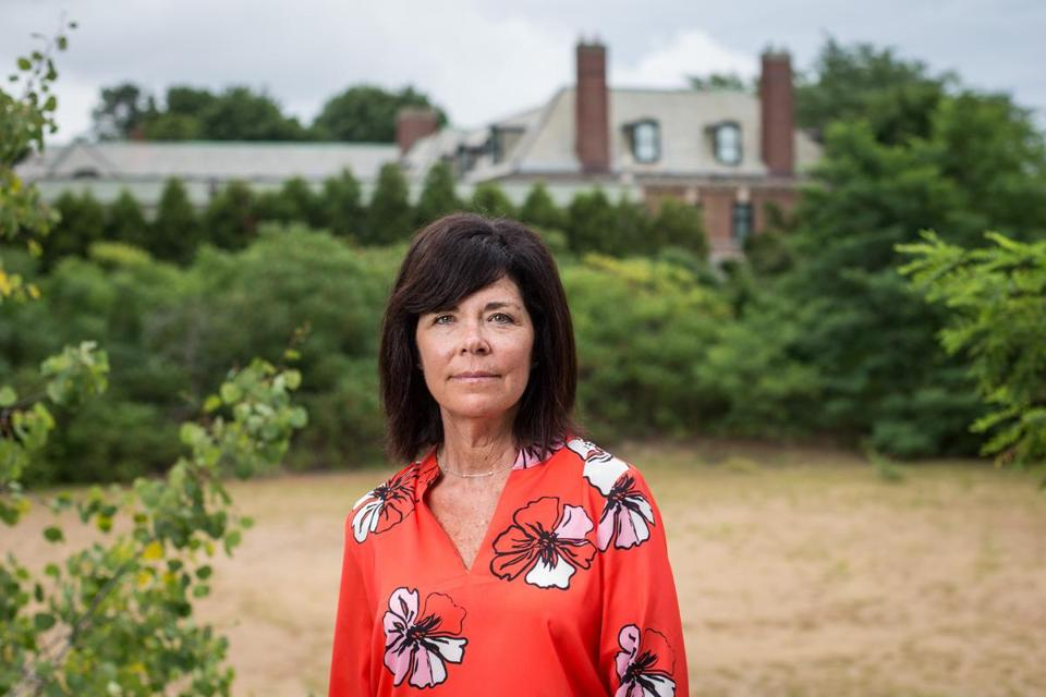 08/01/2016 BEVERLY, MA Lorena Wile (cq) poses for a photo at her property in Beverly where she is not allowed to build due to a dispute with her neighbor. (Aram Boghosian for The Boston Globe)