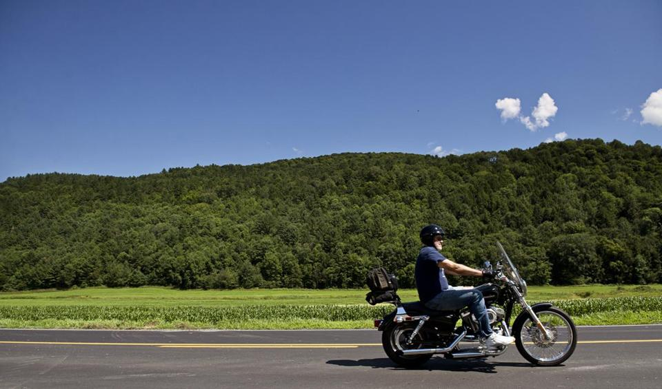 05roadpitch - A motorcyclist travels between pitch sessions during the Fresh Tracks Capital Road Pitch on Route 14 in Williamstown, Vt., on Wednesday, Aug. 3, 2016. Over the course of five days venture capitalists traveled across the state by motorcycle to meet with entrepreneurs and startup companies. (Paul Hayes For The Boston Globe)