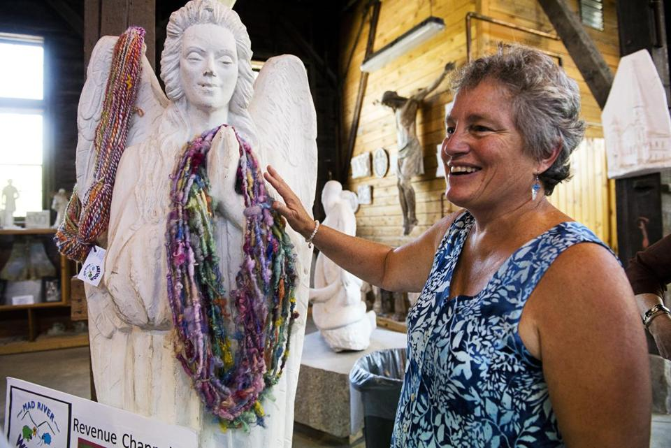 05roadpitch - Vee Lynch of Mad River Woolery stands with her work draped over a statue during the Central Vermont Road Pitch at the Vermont Granite Museum in Barre, Vt., on Wednesday, Aug. 3, 2016. (Paul Hayes)