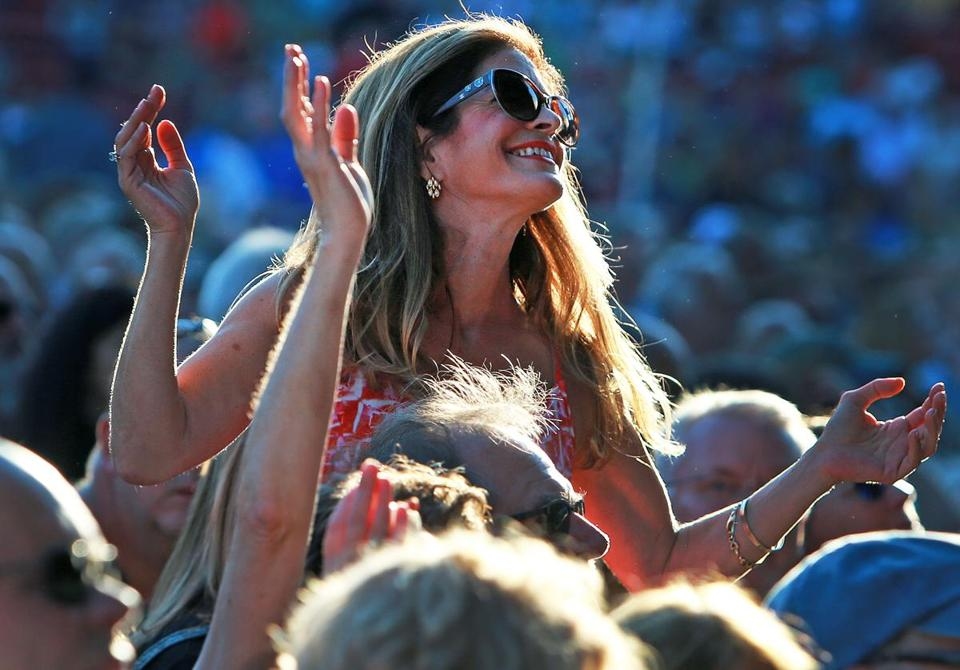 08/03/16: Boston, MA: A fan dances as she enjoys listening to Jackson Browne as he opens for James Taylor at Fenway Park. (Globe Staff Photo/Jim Davis) section:living topic: 05taylor