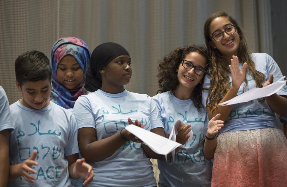 8/7/2016 - Newton, MA - Temple Beth Avodah - From left: Adel Jahboub, cq, of Jerusalem; Maryam Yusuf, cq, of Boston; Khadijah Abdurrashid, cq, of Boston; Yasmine El-Kattan, cq, of Lexington; and Loure Siniora, cq, right, of Jerusalem, were several of the young adults involved in the Kids4Peace Boston program who gave a presentation at Temple Beth Avodah in Newton on Sunday afternoon, August 7, 2016, about their peace-building experiences. Topic: 08peacekids. Dina Rudick/Globe Staff.