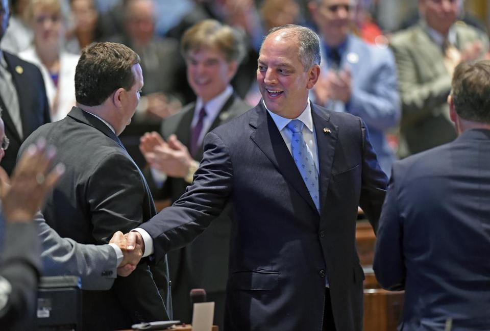 Louisiana Gov. John Bel Edwards enters the House chamber to address a joint meeting of the Louisiana legislature to open the second special session Tuesday, June 7, 2016, in Baton Rouge, La. (Bill Feig/The Advocate via AP) MAGS OUT; INTERNET OUT; NO SALES; TV OUT; NO FORNS; LOUISIANA BUSINESS INC. OUT (INCLUDING GREATER BATON ROUGE BUSINESS REPORT, 225, 10/12, INREGISTER, LBI CUSTOM); MANDATORY CREDIT