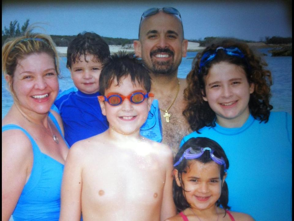 Jay Hajj, owner of the popular Mike's City Diner, and his family enjoying sand and surf.