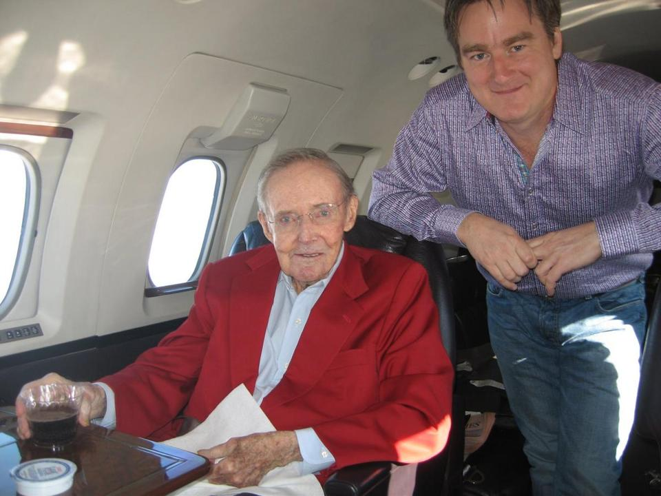 Paul English with Tom White on a jet English chartered as part of a gift vacation for White and his wife.