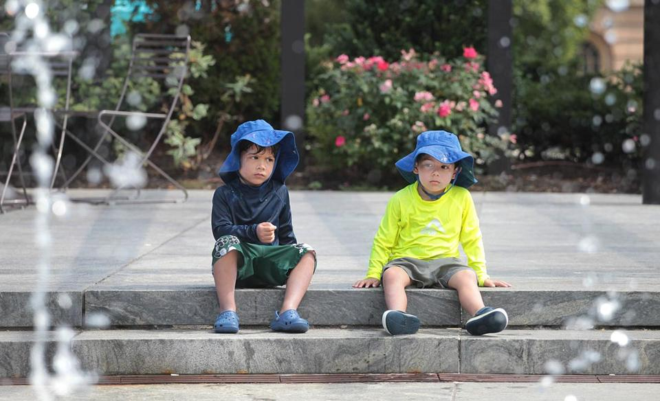 Boston, MA., 08/11/16, Trying to keep cool in the fountains at the Rose Kennedy Greenway are twins Gabriel and Alesar Haroon, cq, who are three years old. Suzanne Kreiter\Globe staff