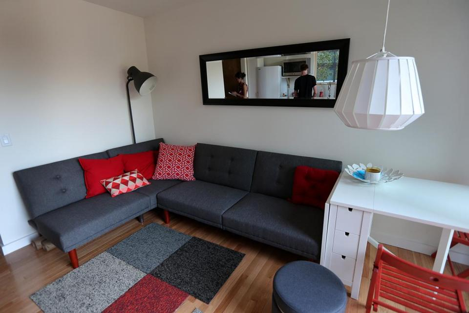 The uHu's living room features a couch that can be pulled out into a bed.