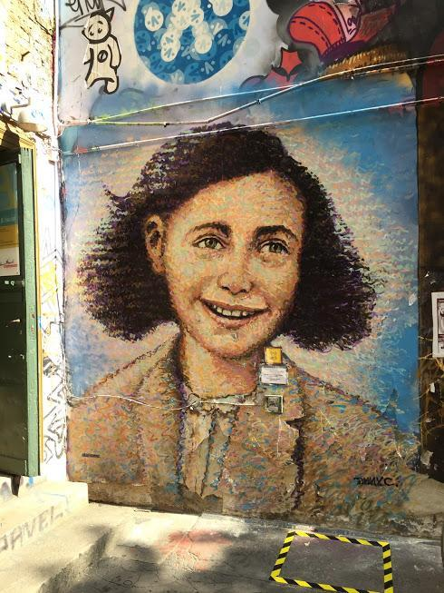 "25Germany - Efforts to remember the Holocaust are ongoing; the street artist James Cochran, or ""Jimmy C."", completed this mural of Anne Frank outside the Anne Frank Zentrum, an exhibit in central Berlin, in 2012 on a commission from street art groups and the Anne Frank Museum. (Benjamin Samuels)"