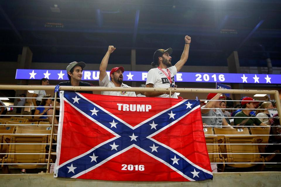At a Trump rally, a Confederate flag goes up, and quickly comes ...