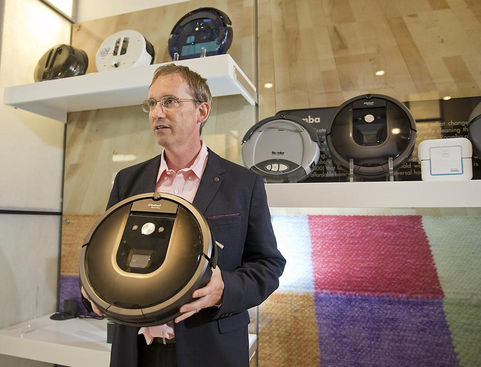 Bedford MA 8/12/16 iRobot CEO Colin Angle holding their newest product the iRobot Roomba 980 in their company headquarters on Friday August 12, 2016. (Photo by Matthew J. Lee/Globe staff)