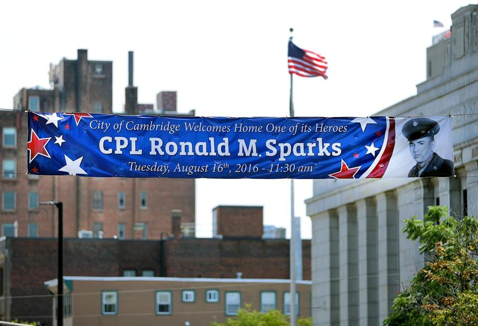 Cambridge-08/13/2016- A banner honoring Army Corporal Ronald M. Sparks, who's body was recently identified after he was killed in korea, hangs over mass. Ave in front of Cambridge City Hall. The Cambridge Post Office(right). Boston Globe staff photo by John Tlumacki(metro)
