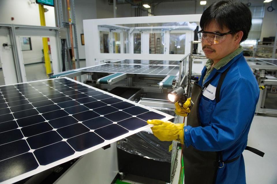 A worker checked solar panels at a Flextronics facility in Milpitas, Calif.