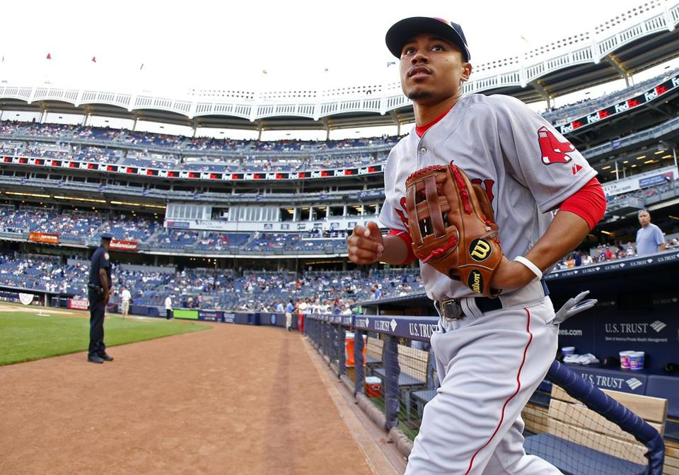 NEW YORK, NY - JUNE 28: Mookie Betts #50 of the Boston Red Sox takes the field before the start of a game against the New York Yankees at Yankee Stadium on June 28, 2014 in the Bronx borough of New York City. (Photo by Rich Schultz/Getty Images)