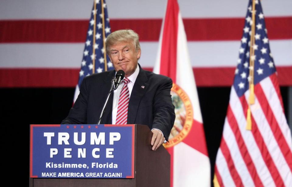 (FILES) This file photo taken on August 10, 2016 shows Republican presidential candidate Donald Trump addressing supporters during a campaign rally at Silver Spurs Arena inside the Osceola Heritage Park in Kissimmee, Florida. Donald Trump announced August 17, 2016 he has again shaken up his senior campaign staff, appointing a conservative website executive and a pollster to head his team amid sinking poll numbers. The Republican presidential nominee also announced that this week his campaign will launch TV ads for the first time. Trump's reluctance to buy TV spots has raised eyebrows as his unorthodox quest for the White House has run into trouble in recent weeks. / AFP PHOTO / Gregg NewtonGREGG NEWTON/AFP/Getty Images