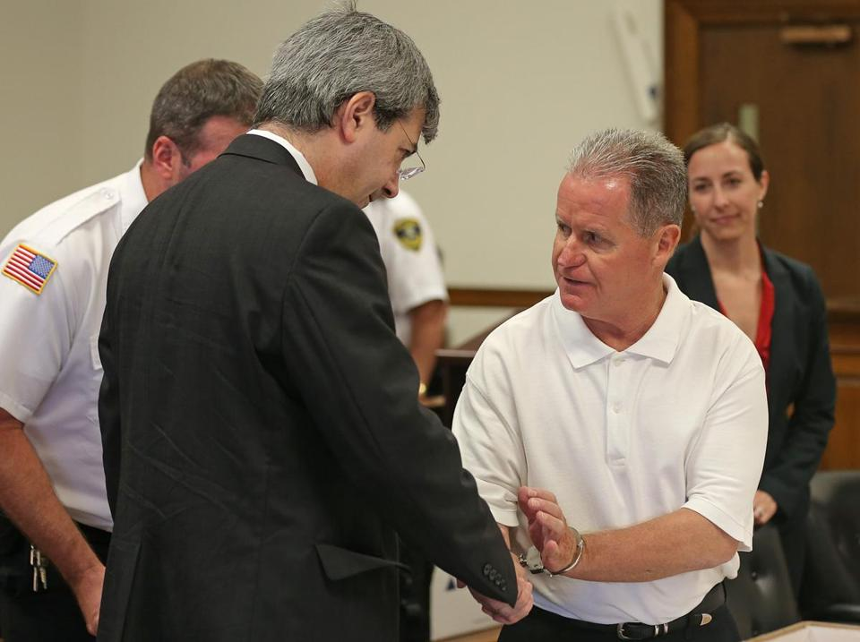 Attorney Michael Ricciuti (left) shook hands with his client, Fredrick Weichel, who has spent 35 years in prison for a murder he insists he did not commit.