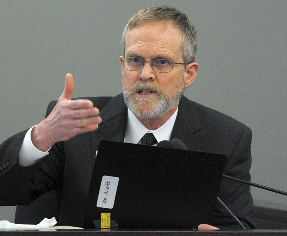 State medical examiner Henry Nields testified during Nathaniel Fujita's murder trial in 2013.