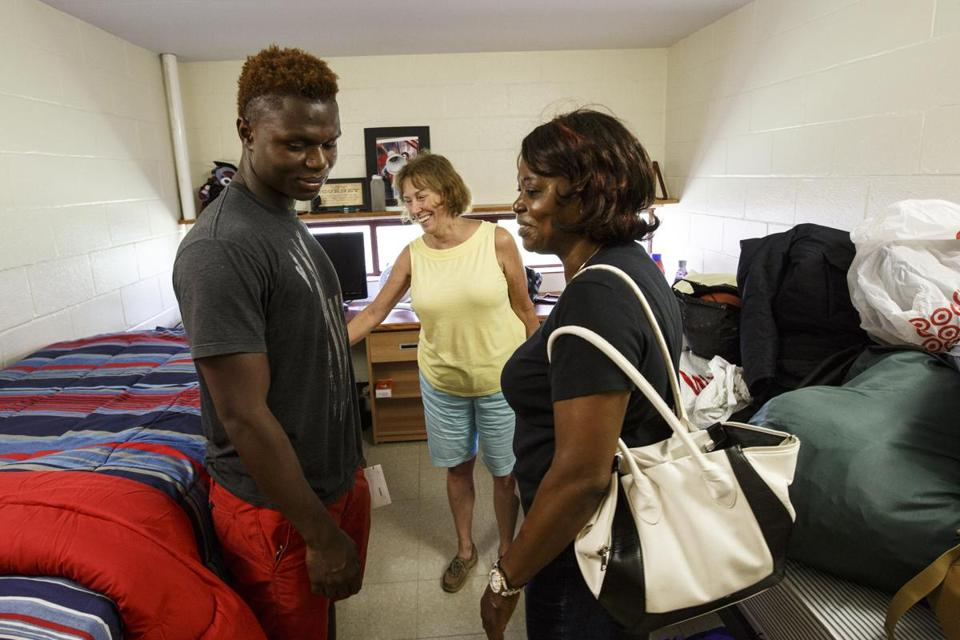Pat Arcand smiled with Tomell Kelley and his grandmother Sophia Weah as Tomell moved into his dorm room at Springfield College.