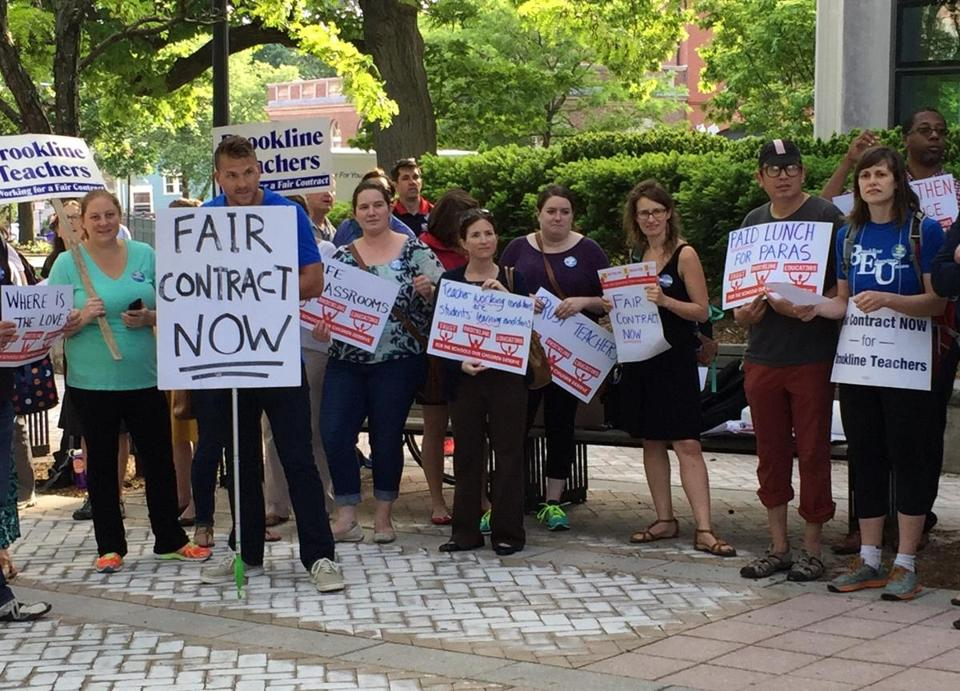 Parents and teachers demonstrated in June outside Brookline Town Hall.